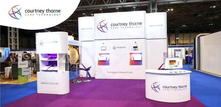 Courtney-Thorne-stand-purple-carpet-exhibiting