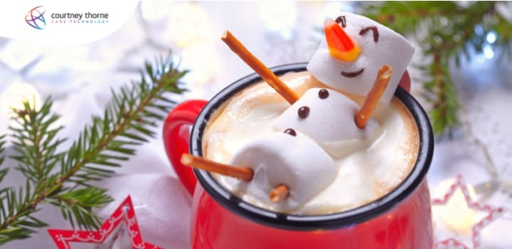 marshmallow-snowman-smiling-n-a-cup-of-hot-chocolate-red-cup-christmas-branches-from-christmas-tree